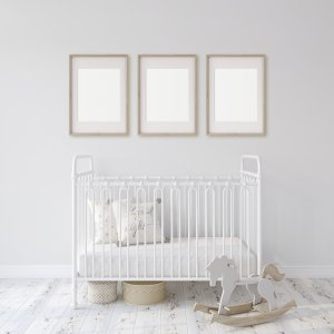 Photo of a baby's room with a crib, rocking horse and three pictures all in shades of white to represent online postpartum depression counseling in Minnesota. Our online therapists can help you with your mental health.