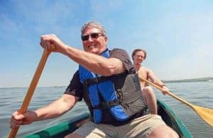 Photo of man in canoe on the water after attending an online therapy session with Synergy eTherapy | Online Therapy in WI | Synergy eTherapy