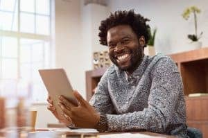 smiling african american man during online therapy with synergy etherapy online counseling and online therapy for anxiety