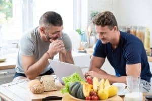 gay couple meets with a synergy eTherapist for online couples therapy in the United States with Synergy eTherapy for online marriage counseling and online therapy for telehealth today.